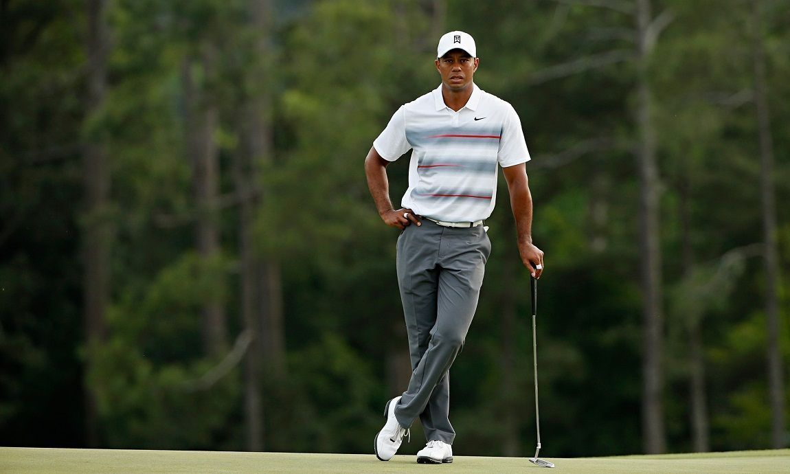 Tiger Woods wait to play on the 18th hole at Augusta on Thursday.